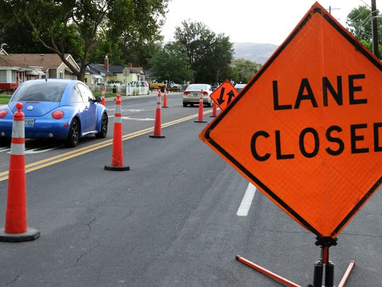 A line of cars drive through construction work along Prater Way near Stanford Way on Aug. 11, 2014.