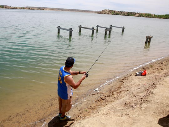 Gabriel Salazar of Bloomfield gets some fishing in on Friday June 3, 2016, at Farmington Lake.