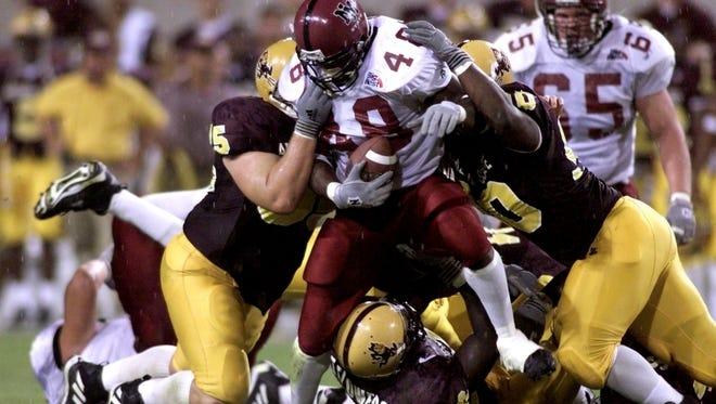 New Mexico State's Keeon Johnson breaks through the ASU defense on Sept. 17, 1999.