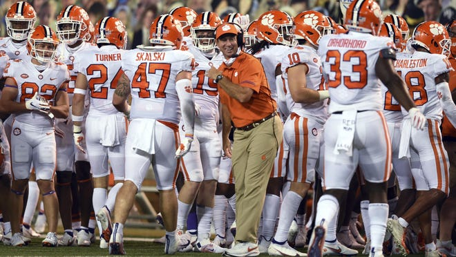 Clemson head coach Dabo Swinney celebrates with the defensive after a Wake Forest turnover in an NCAA college football game, Saturday, Sept. 12, 2020 at Truist Field in Winston-Salem, N.C.