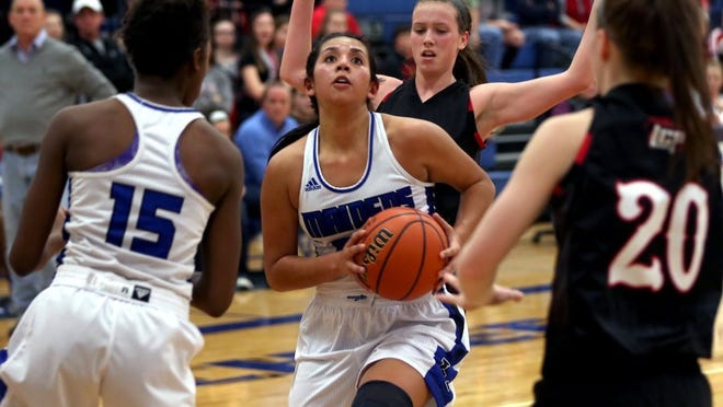 Adam Sauceda/Standard-Times Lake View's Bri'Ana Soliz looks to go for a layup during Friday's game against Lubbock Cooper. Soliz had 12 points in the 73-67 loss. Shot/Archived:01.08.16