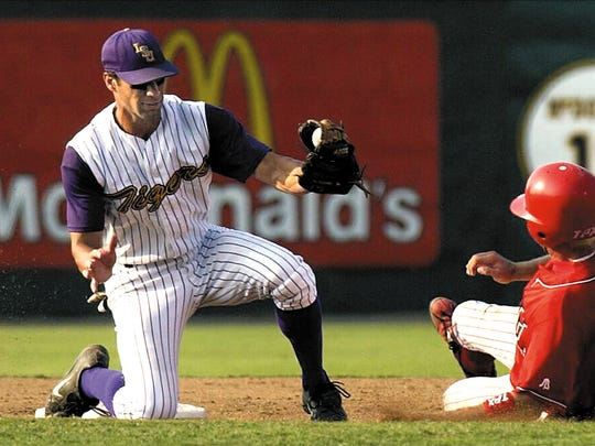 LSU's Rocky Scelfo,left, gets ready to tag out UL's