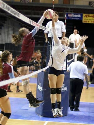 Silver's Asia Morales hangs tough at the net during semifinal play in the state tourney in Rio Rancho.