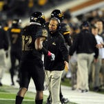 Southern Miss head coach Todd Monken speaks to his players during a game against North Texas on Saturday at M.M. Roberts Stadium.