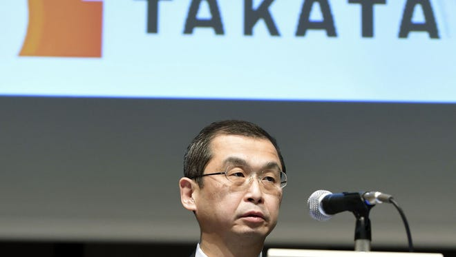 In this Nov. 4, 2015 file photo, Japanese air bag maker Takata Corp. CEO Shigehisa Takada speaks at a press conference in Tokyo.