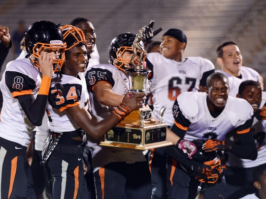Cocoa High players pose for photos with the BBQ Bowl