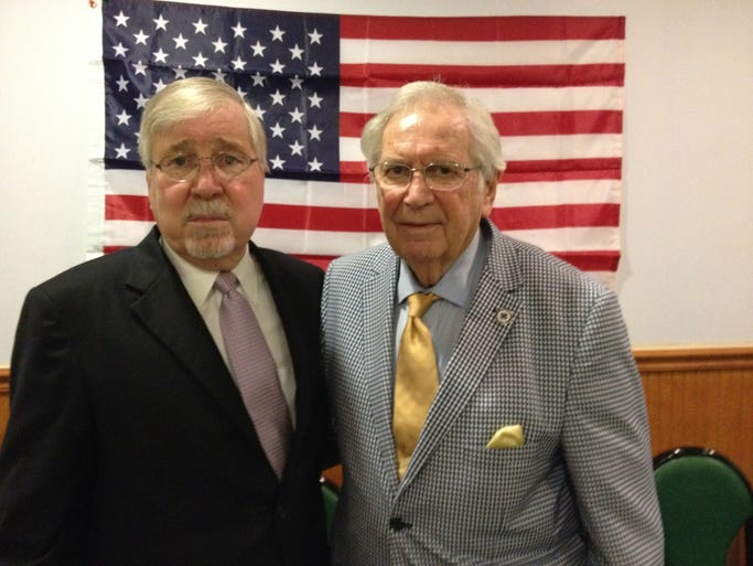 District Attorney Jerry Jones, left, visits with Fred Huenefeld of the Sons of the American Revolution at a recent meeting where Jones spoke on drugs and crimes and their effects on the economy.