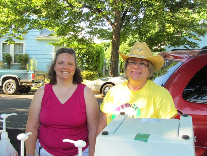 Tina Hayworth and Linda Woods attend Southeast Salem Neighborhood Association Summerfest on July 12, 2014.