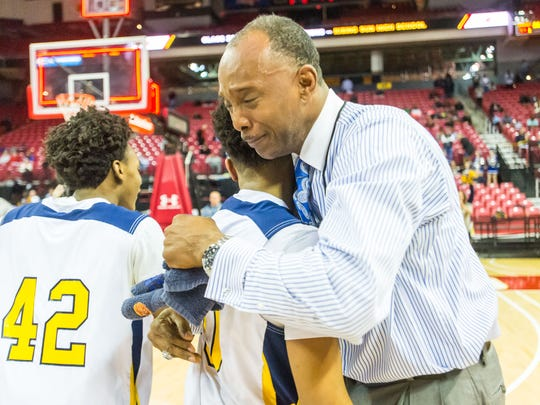 Pocomoke head coach Derrick Fooks hugs point guard Tyler Nixon (10) after winning the MPSSAA 1A State Championship against Lake Clifton at the Xfinity Center in College Park on Saturday, March 12.