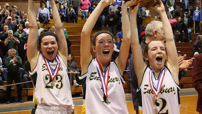 Enosburg captains, from left, Emilee Bose, Phelan Howell and Brooke St. Onge pose with trophies after their 52-37 win over Thetford in the Division III high school girls basketball championship game at Barre Auditorium on Saturday.
