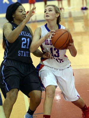 Volunteer State Community College freshman guard Haley Depriest penetrates into the lane during second-quarter action as Cleveland State sophomore JLynn Majors defends. Depriest scored two points in the Lady Pioneers' 68-58 loss on Nov. 20, 2015.