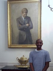 Darius Geer. president of the Tri-County Technical College Association of Political Scientists, stands near a portrait of John F. Kennedy while visitingthe White House earlier this year.