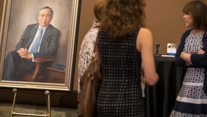 A portrait of Bobby Fong in a foyer during a celebration of life for the former Butler University president Sunday at Clowes Hall.