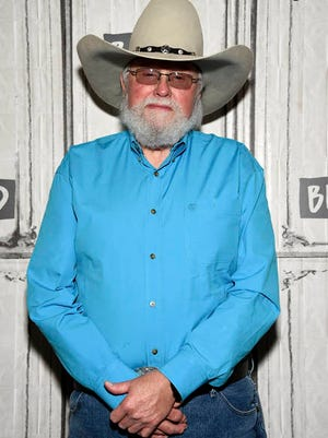 """In this Oct. 23, 2017 file photo, country music artist Charlie Daniels participates in the BUILD Speaker Series to discuss """"Never Look at the Empty Seats: A Memoir"""" in New York. Daniels who had a hit with """"Devil Went Down to Georgia"""" has died at age 83. A statement from his publicist said the Country Music Hall of Famer died Monday due to a hemorrhagic stroke."""