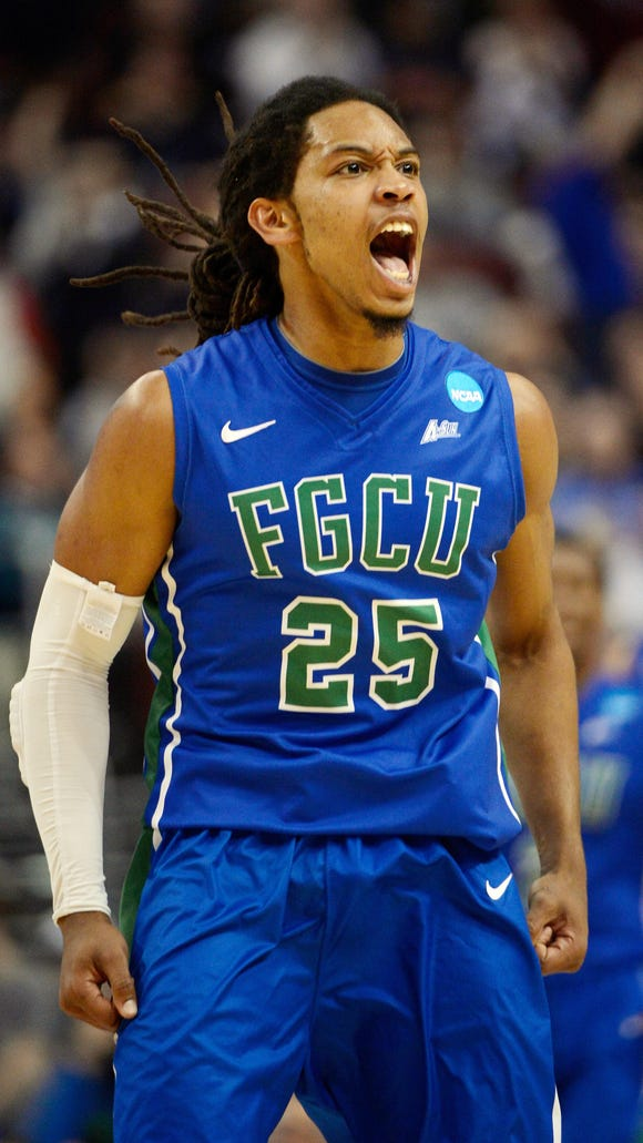 Mar 22, 2013; Philadelphia, PA, USA; Florida Gulf Coast Eagles guard Sherwood Brown (25) celebrates after making a basket against the Georgetown Hoyas during the second half in the second round of the 2013 NCAA tournament at the Wells Fargo Center. Mandatory Credit: Eileen Blass-USA TODAY Sports
