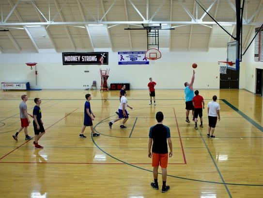 Students play basketball during a physical education