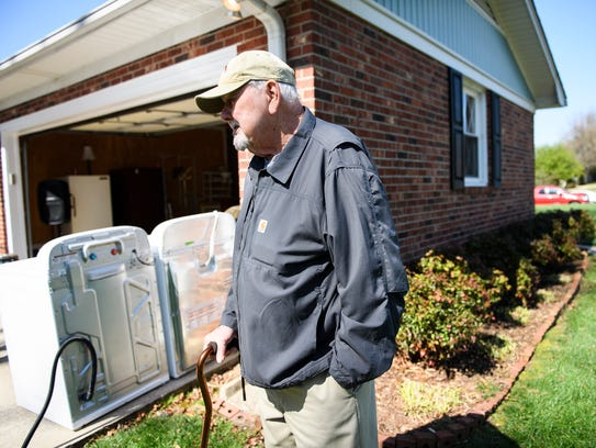 Bud Boozer stands in front of his home in Mauldin before