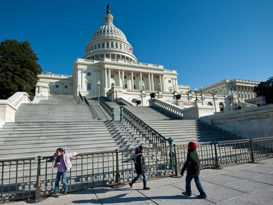 Three children play by the US Capitol in Washington on January 4, 2011, one day before before the Republican-led 112th Congress covenes for the first time. AFP PHOTO/Nicholas KAMM (Photo credit should read NICHOLAS KAMM/AFP/Getty Images)