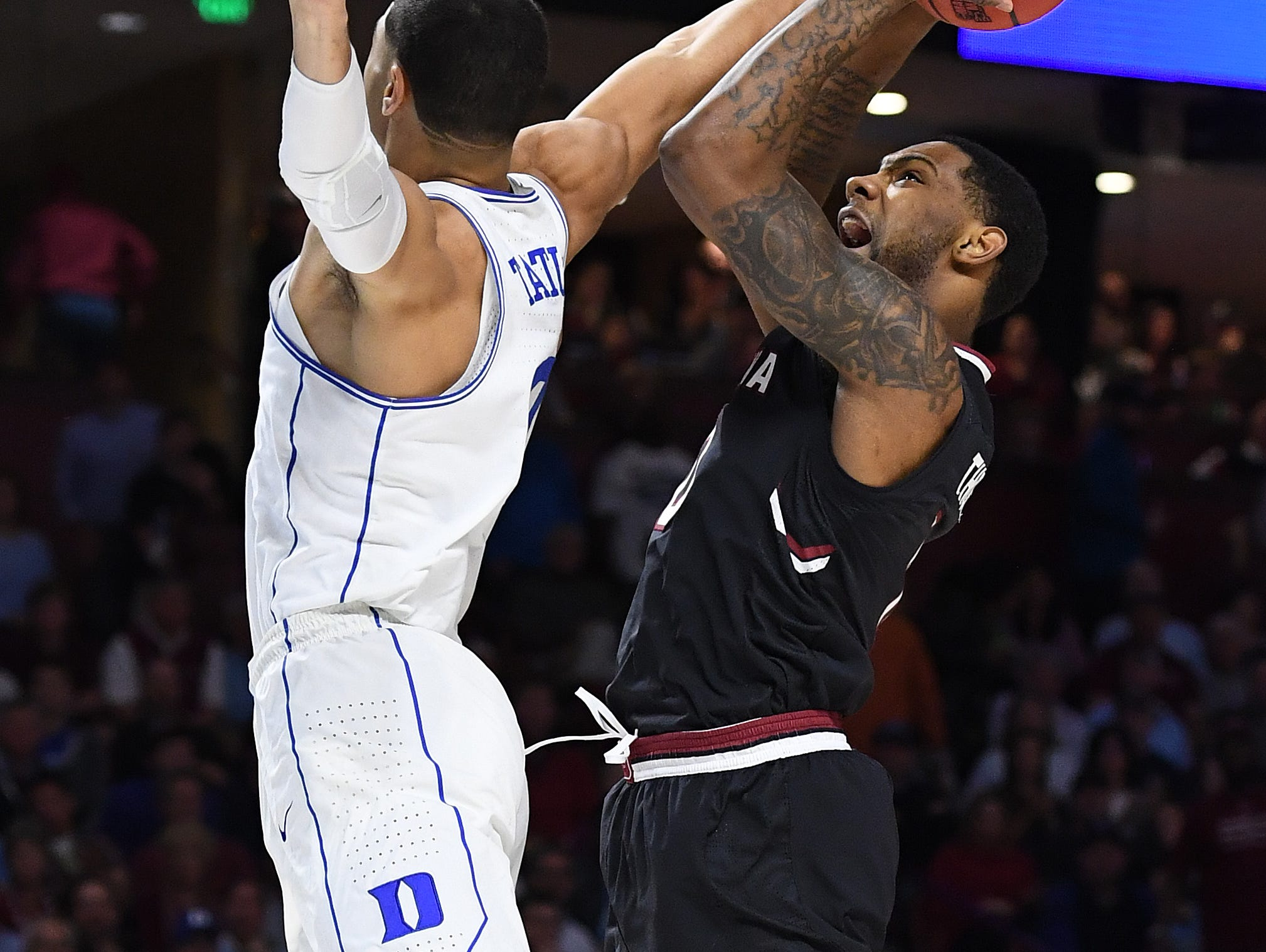 South Carolina guard Sindarius Thornwell (0) tries to shoot over Duke forward Jayson Tatum (0) during the 2nd round of the NCAA Tournament at Bon Secours Wellness Arena in downtown Greenville on Sunday, March 19, 2017.