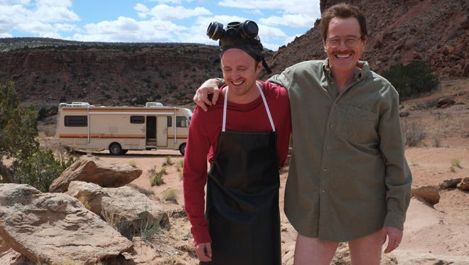 The ones who knock: Aaron Paul, left, and Bryan Cranston smile on the last day of shooting AMC's 'Breaking Bad' in 2013. The drama premiered 10 years ago on Jan. 20, 2008.
