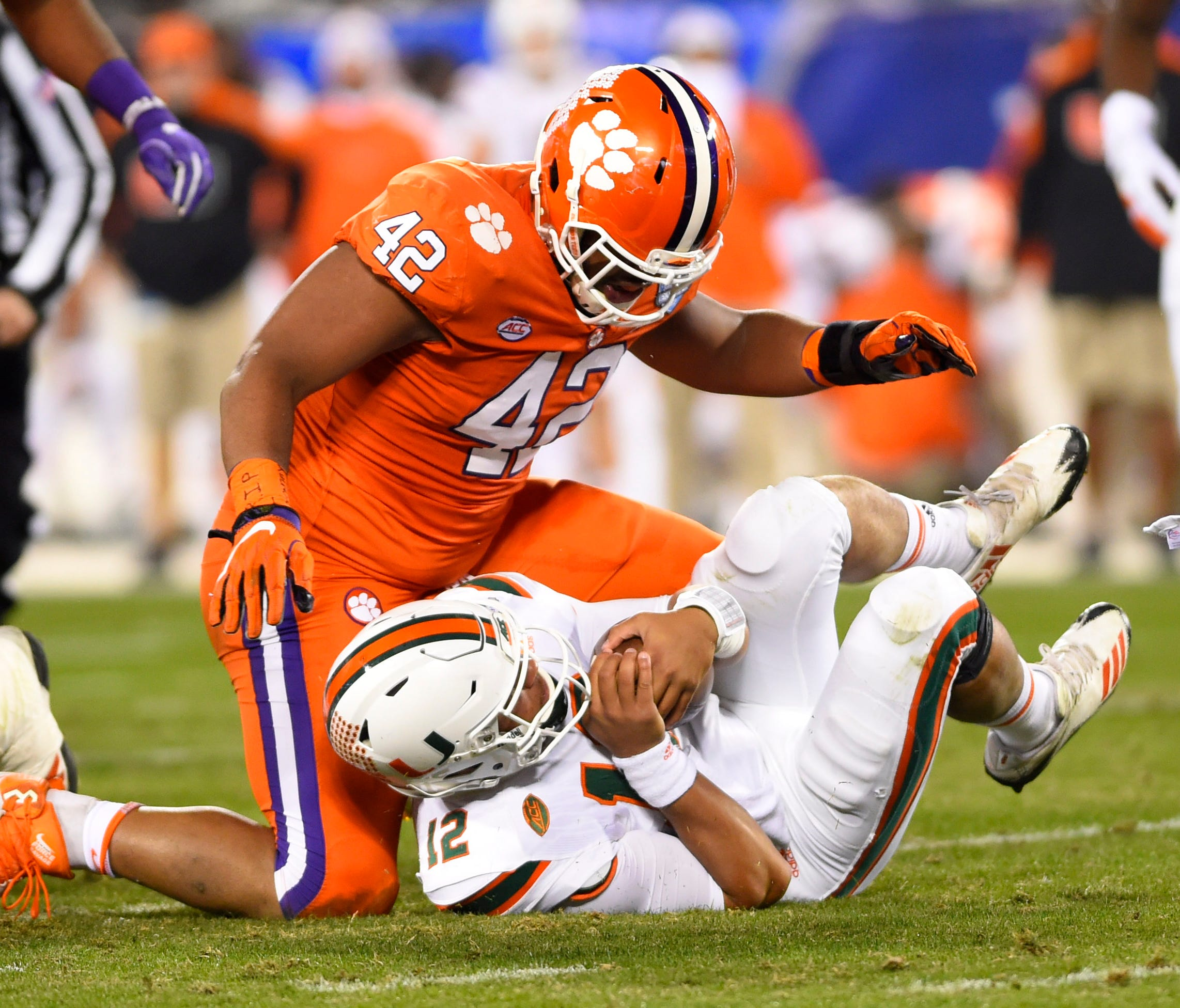 Clemson defensive lineman Christian Wilkins sacks Miami (Fla.) quarterback Malik Rosier during the ACC championship game in 2017.