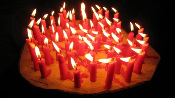 Birthday candles -- a long and slobbery tradition.