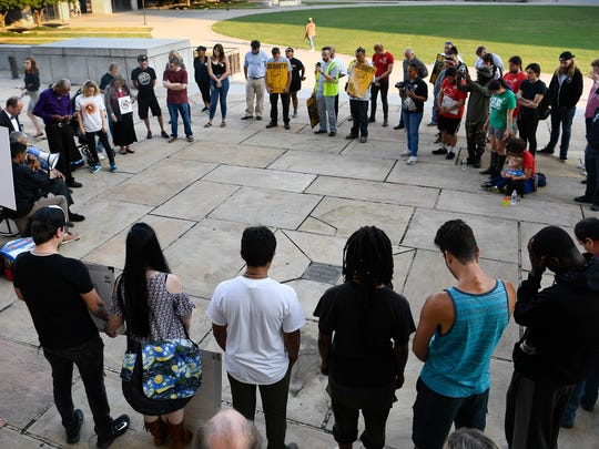 Protestors gather outside the Metro Courthouse to rally for the changing of Columbus Day holiday to Indigenous People's Day Tuesday, Sept. 19, 2017 in Nashville, Tenn.