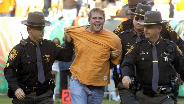 Greg Gall, then 31 of Mount Washington, is led away by deputies after running onto the field at Paul Brown Stadium during a game against the Green Bay Packers Oct. 30, 2005.