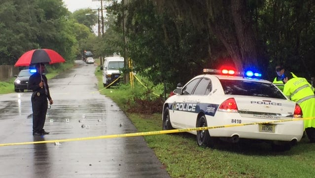 Titusville police at the scene where the SUV crashed into a tree.