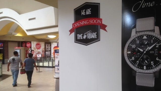 A sign hides the new Time Square store opening Thursday in Cielo Vista Mall.