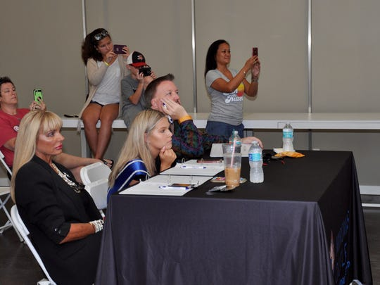 Miromar Has Talent judges evaluate a performance by Jolie Thomas-Grote as friends and family members video during the final competition June 24 at Miromar Outlets.