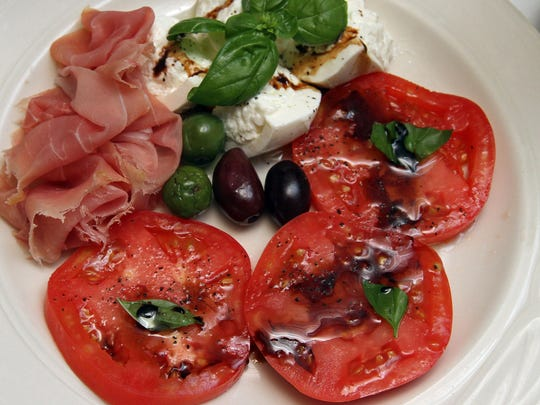 Vincenzo's Ristorante in Middlesex is owned by Rui Alves. This is their Borat mozzarella with fresh Jersey tomatoes and prosciutto de parm.