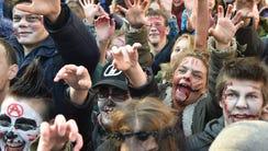 People take part in a Zombie Walk event in Kiev on