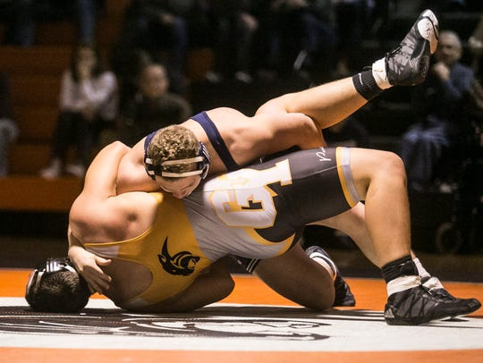 Dallastown's Bryce Shields, flips and pins Central