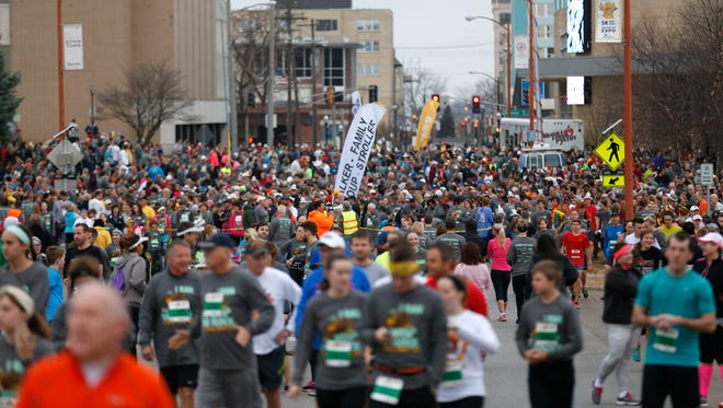 People find their places as they line up to run in the 21st Annual Turkey Trot 5K Run/Walk on Thursday, Nov. 25, 2015. About 7,700 runners participated in the Thanksgiving morning Run/Walk.
