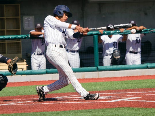 ALBUQUERQUE NM - May 23, 2015 Jose Valenzuela of the De Valle Conquistadores swings for a hit during their match against Randall Raiders in Albuquerque NM, at the UNM Lobos field. The Randal Raiders beat the Del Valle Conquistadores 8-5.
