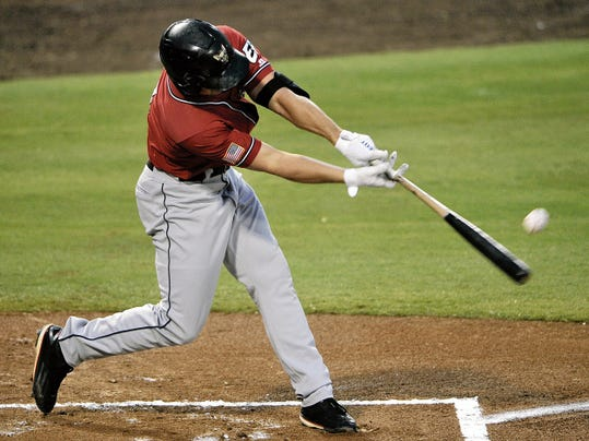 El Paso's Hunter Renfroe connects for a single in the first inning in the second game of playoff action against Fresno Grizzlies Thursday, September 10, 2015 in Fresno, Calif.