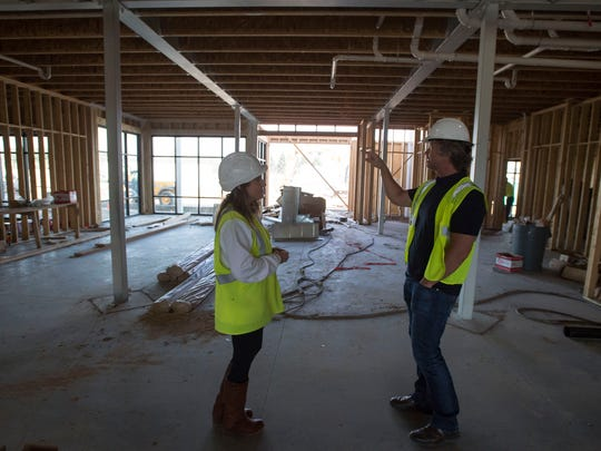 Senior vice president of development with Spirit Hospitality Moira Bright, left, and Studio PBA director of hospitality Edwin Mocke walk through what will be the main lobby on Tuesday, April 17, 2018, at the construction site of a Spirit Hospitality hotel at Lady Moon Drive and East Harmony Drive in Fort Collins, Colo.