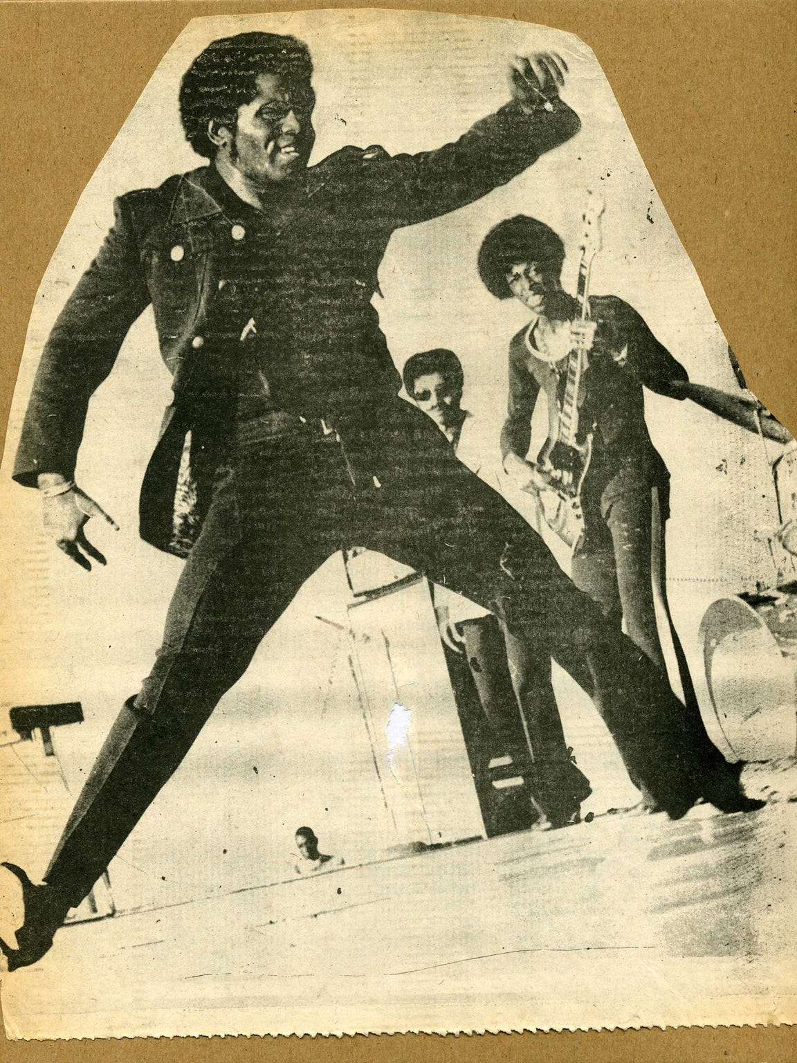 James Brown with Bootsy Collins playing bass in the background, circa 1970.