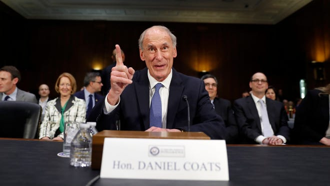 Director of National Intelligence-designate Dan Coats speaks on Capitol Hill in Washington, Tuesday, Feb. 28, 2017, prior to testifying at his confirmation hearing before the Senate Intelligence Committee.