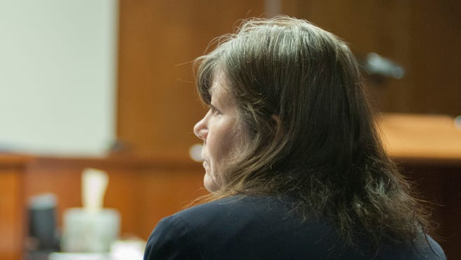 Lynn Higgins, of Cottrellville Township, listens during a preliminary examination Wednesday, July 13 in Marine City District Court. She and her husband, Michael, are charged with animal cruelty to 10 or more animals, 4-year felonies.
