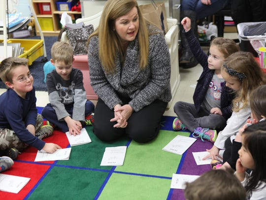 Kindergarten teacher Fran Shea works with her students at the Fulmar Road Elementary School in Mahopac Jan. 15, 2014. Shea talked about how things have changed in the kindergarten classroom since the implementation of the Common Core.