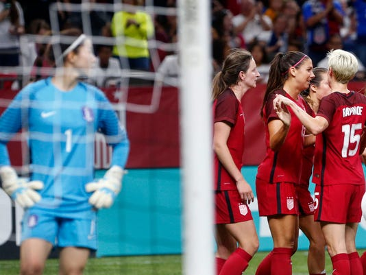 U.S. forward Alex Morgan, in center at right, celebrates her goal with teammates as South Korea goalie Kang Gaae (1) looks toward them during the first half of an international friendly women's soccer game in New Orleans, Thursday, Oct. 19, 2017. The United States won 3-1. (AP Photo/Gerald Herbert)