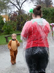 Emrys Yarbrough, 2, of Ferrisburgh, approaches a Shelburne