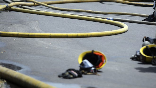 FILE - Firefighters respond to a fire.