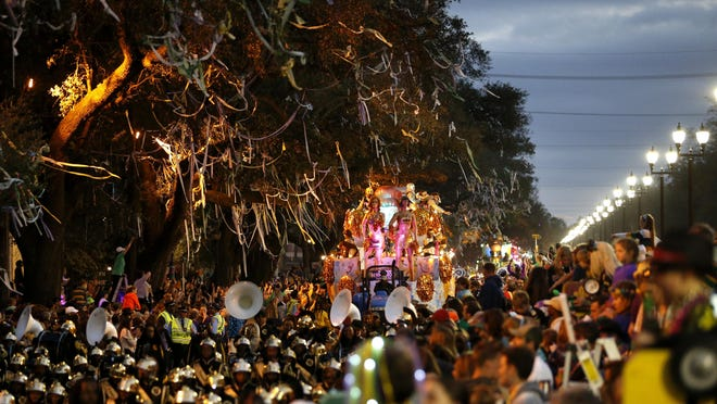 A flat follows a marching band during the Krewe of Bacchus Mardi Gras parade in New Orleans, Sunday, Feb. 26, 2017.