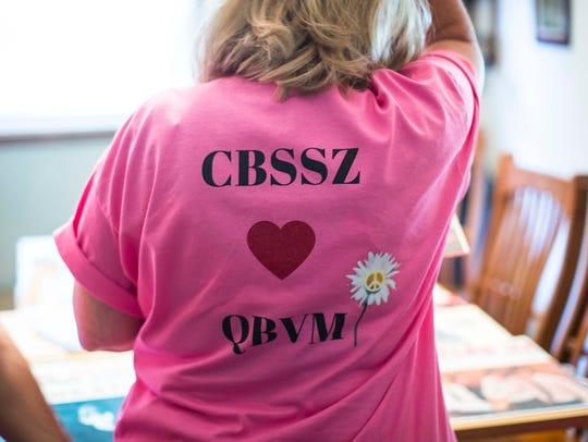 Celeste Eckert shows her coded T-shirt. CBSSZ is code