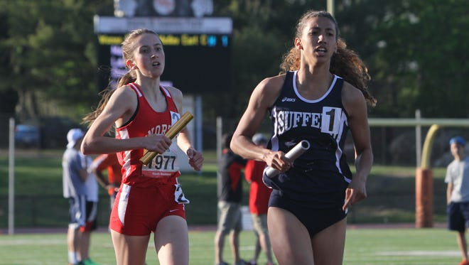 From right, Suffern's Kameryn McIntosh edges out North Rockland's Alex Harris as they head into the last lap of the Women's East Coast Challenge Distance Medley during the first day of the annual Loucks Games at White Plains High School May 7, 2015. Suffern's team won the race.