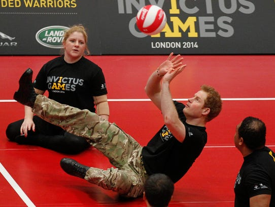 Prince Harry sitting volleyball