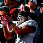 A Philadelphia Eagles fan cheers during the second half of the team's game against the Rams last week.